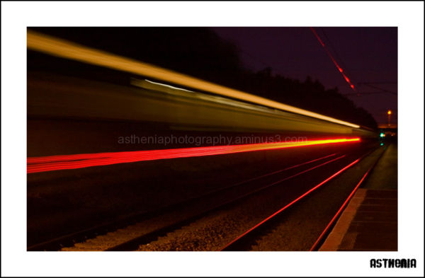 Light trails of a train leaving the station