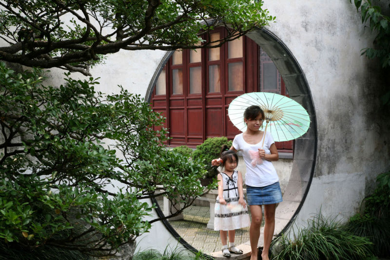 Mother and daughter in a chinese garden