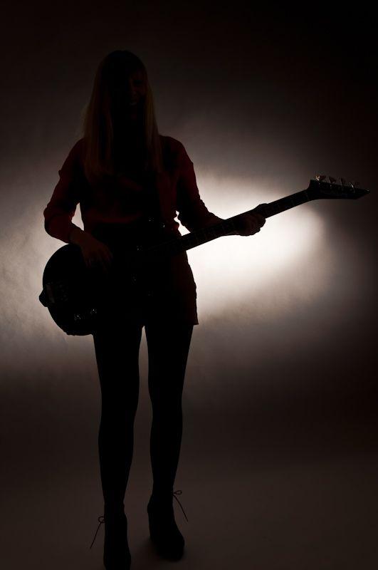 Female bassplayer in silhouette