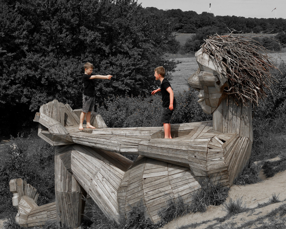 Huge wooden woman as playground