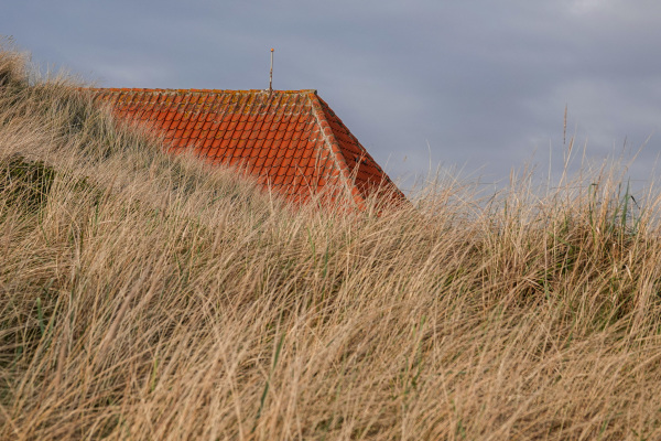 Rooftop behind the sand dunes