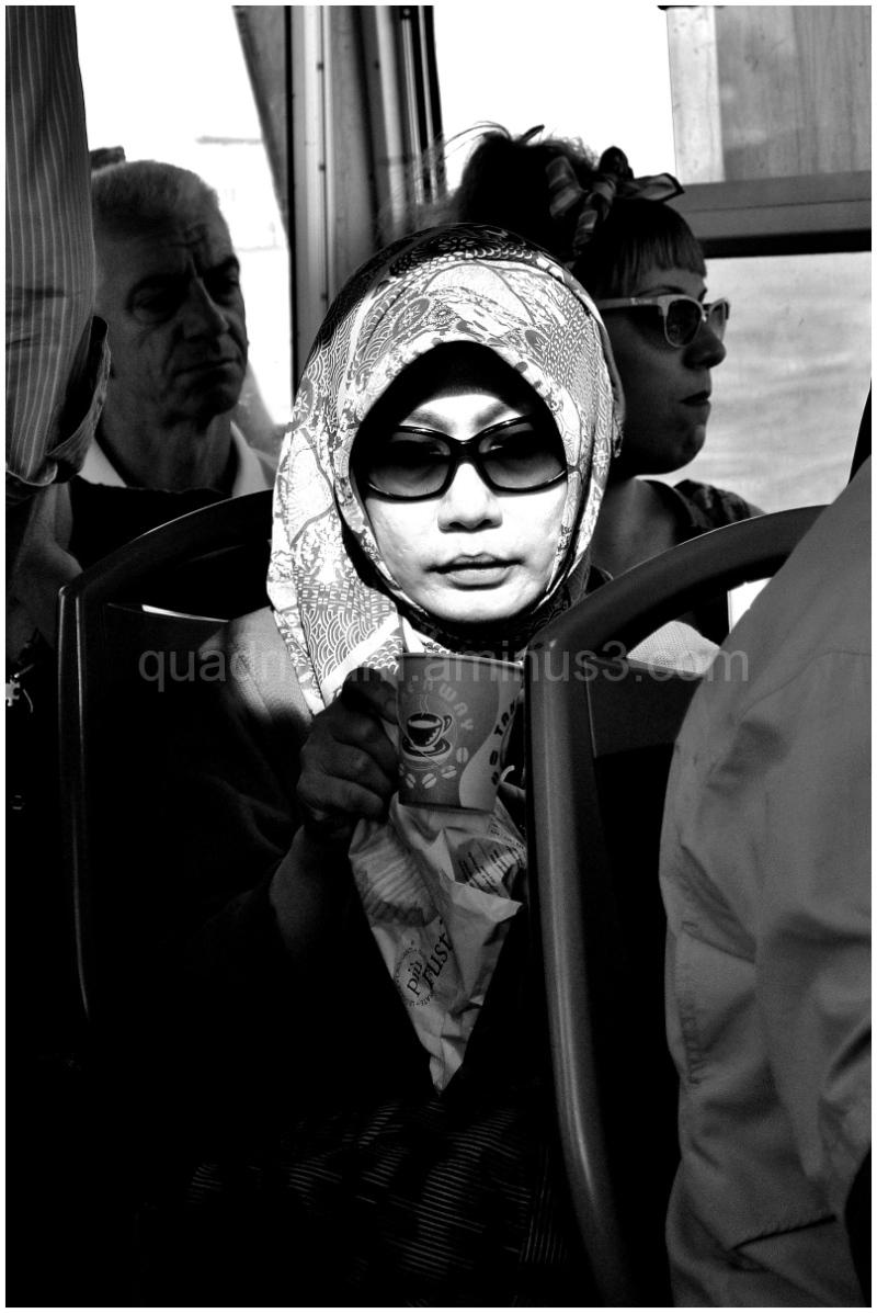 Shot of a woman tourist on Murano ferry, Venice