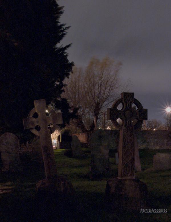 Two gravestones at night