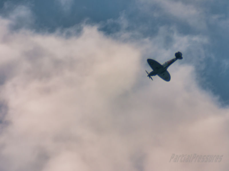 Spitfire heading into clouds