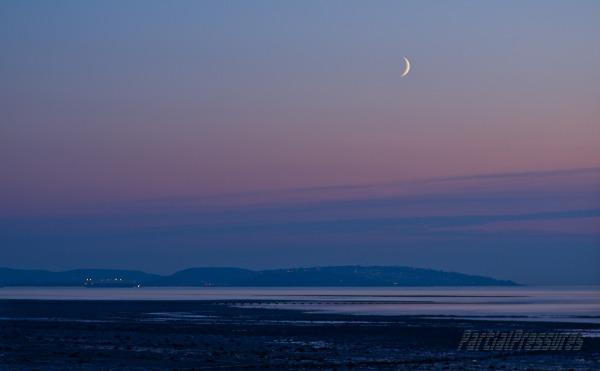 New moon and cargo ship near Portishead