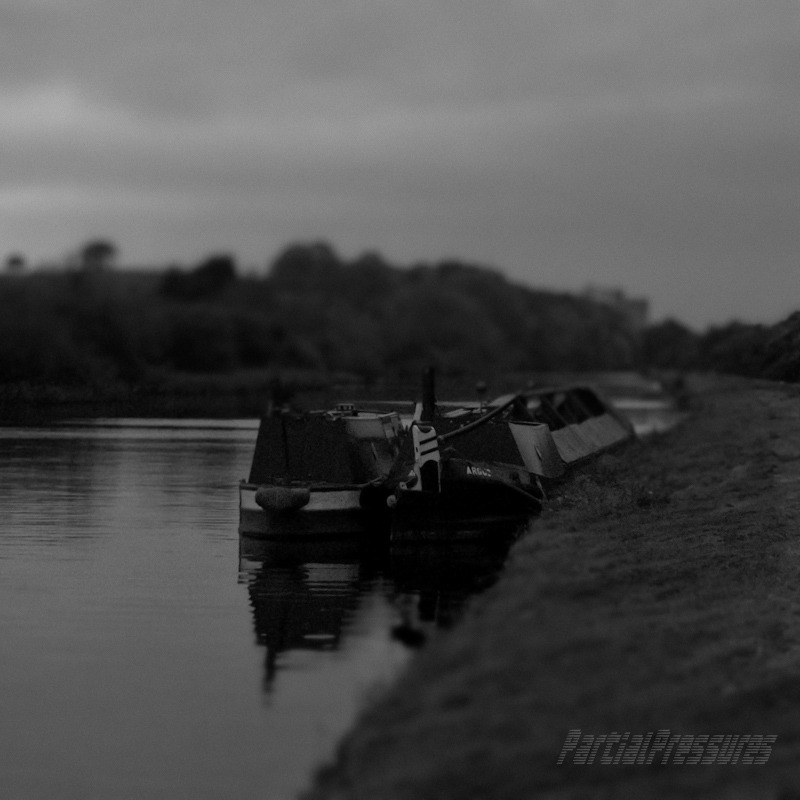 The coalman's two narrowboats moored by the canal