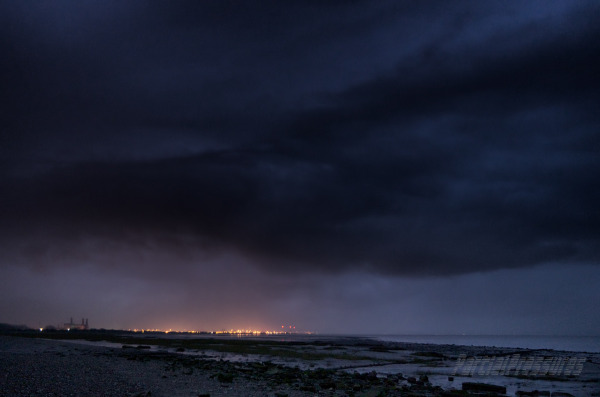 The lights of Avonmouth and a looming storm