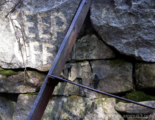 iron ladder against stone wall at abandoned dam