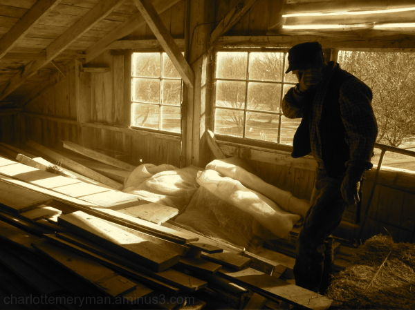 man in dusty Massachusetts barn sepia