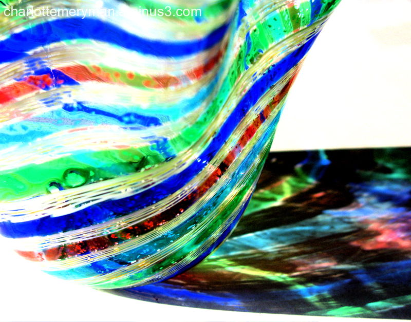 striped glass vase casting colored shadow