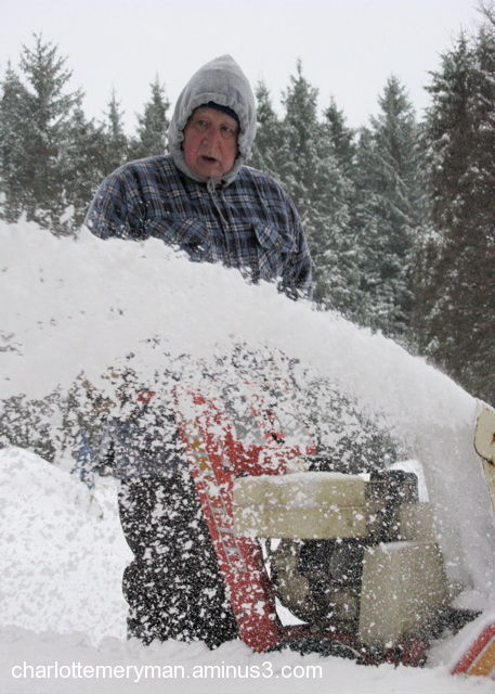 man with snowblower in winter cold