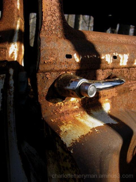 rusted door handle of 195- chevy handyman