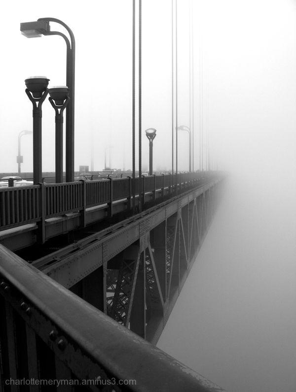 golden gate bridge vanishing in fog b-w
