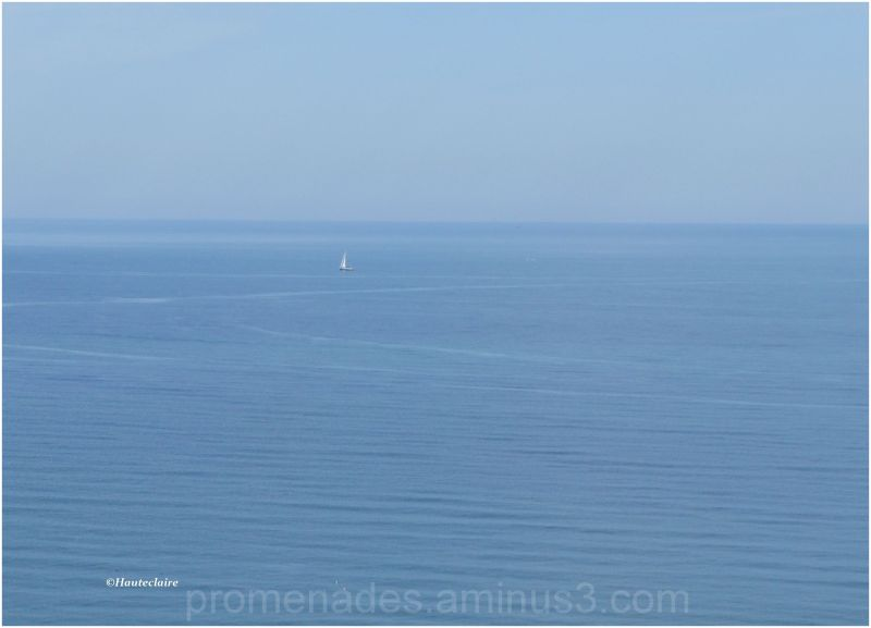 small boat on a deep blue sea