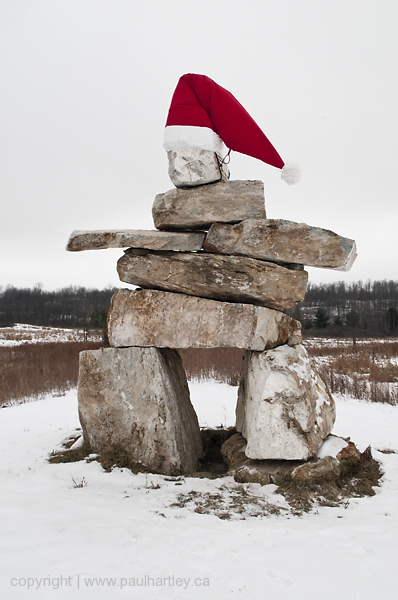 very large inukshuk with santa hat