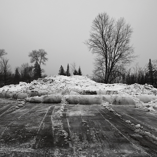 snow bank from ploughed snow parking lot