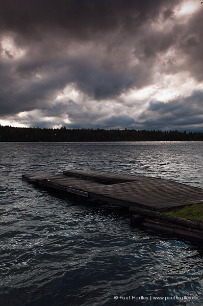 dark stormy weather by a dock on a lake paudash