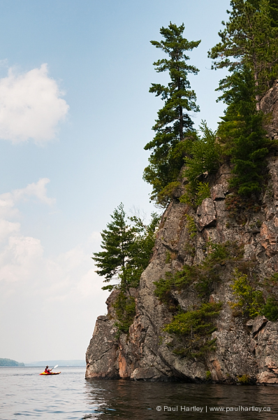 view of high rock with kayak on mazinaw lake
