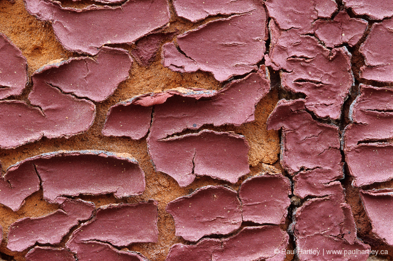 close up of red peeling paint