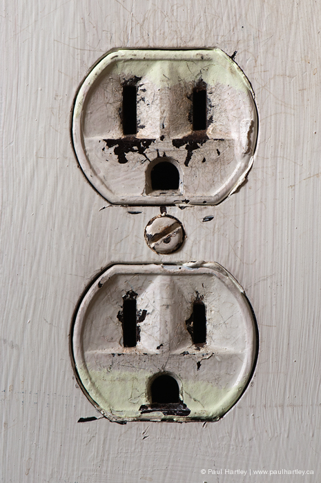 close up of worn ac outlet