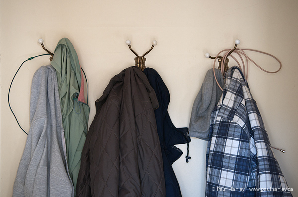 jackets hanging with wire cables blue plaid