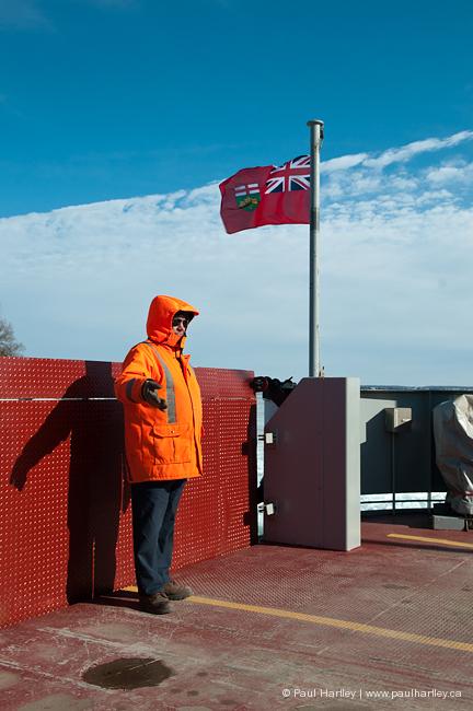 feryman directs traffic on amherst island ferry