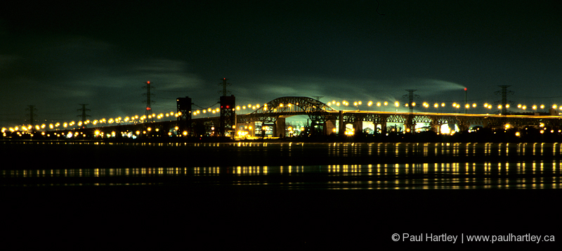 pano of burlington skyway bridge at night