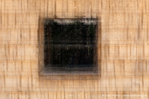 multiple exposure of window and cedar shingles