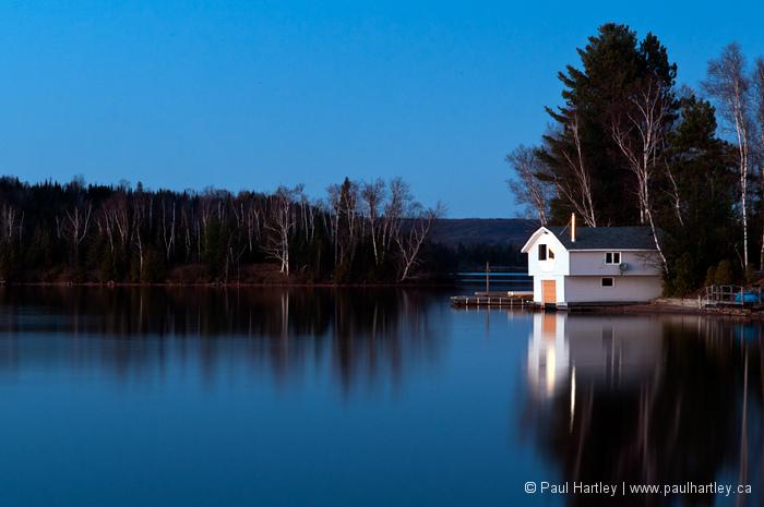 boathouse on paudash lake in evening