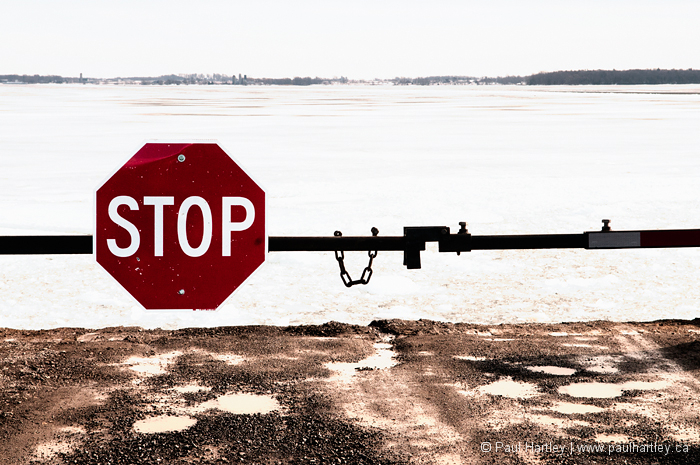 Stop sign at waters edge Lake Ontario