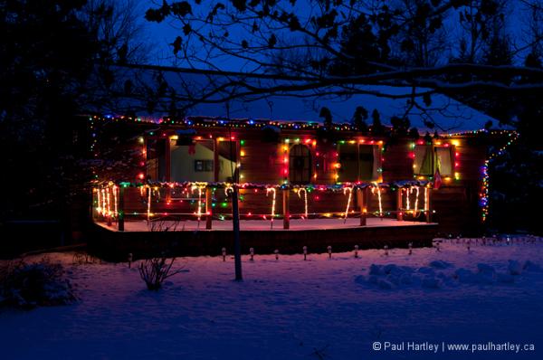 cedar house with christmas lights