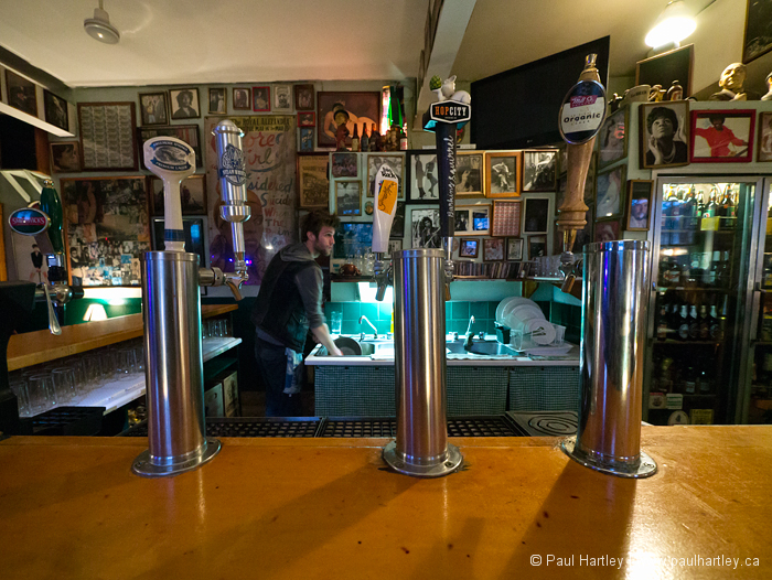 beer taps on a bar and pop culture paraphernalia