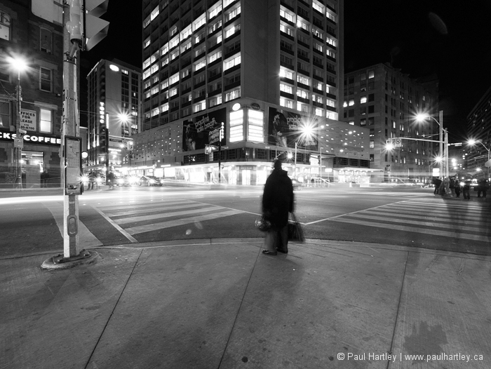 person waiting at city intersection