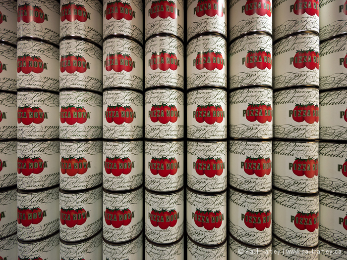 Stacked cans of pizza nova pizza sauce