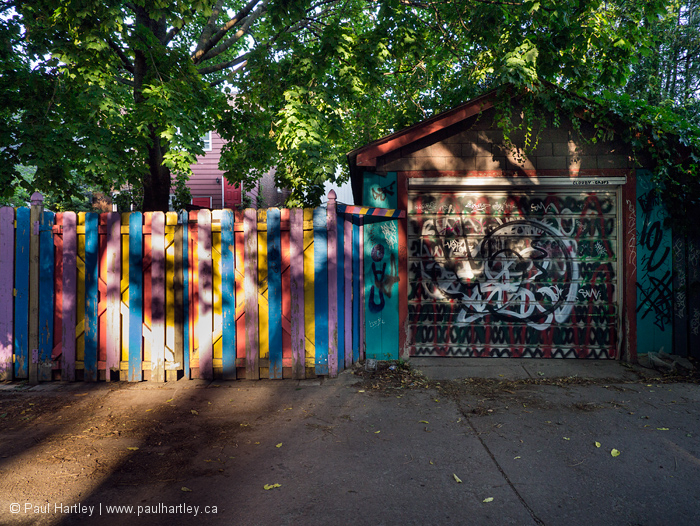 Since and shadow on Colourful fence and garage