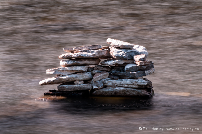 Stacked rocks on the Otonabee river