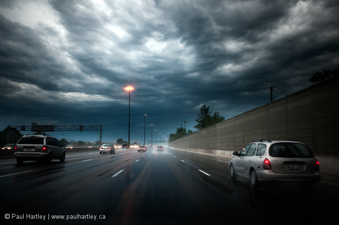 Storm clouds over highway
