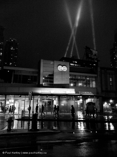 black and white night shot of toronto's go station
