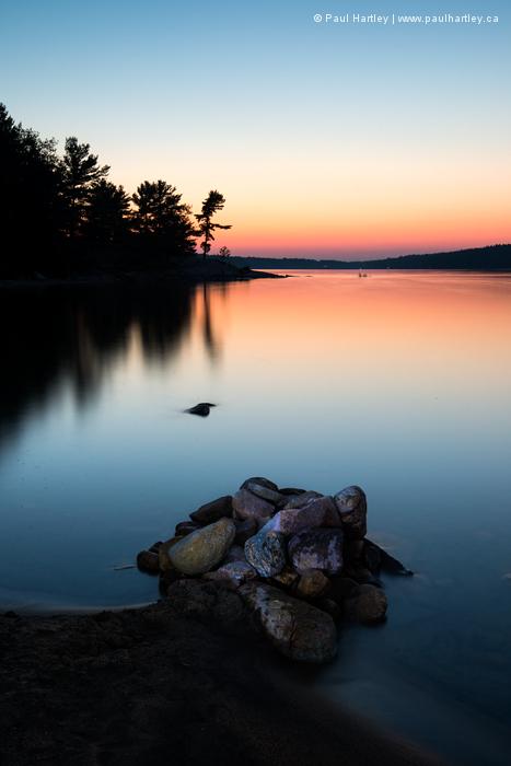 Rocks on a beach at sunset