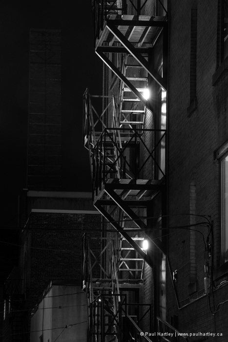fire escape at night with building lights