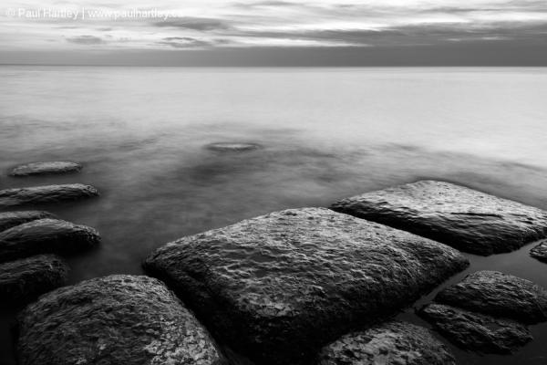 rocks on a shoreline of lake ontario