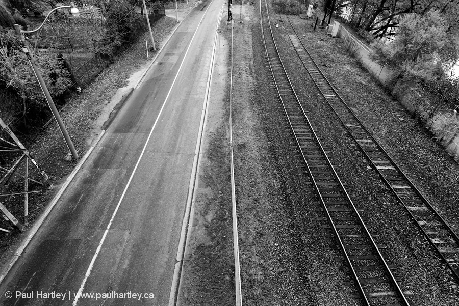 empty road and train tracks