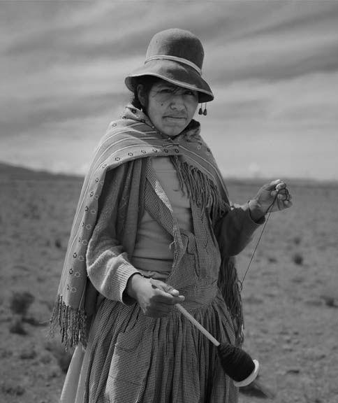 Aymara woman spins wool