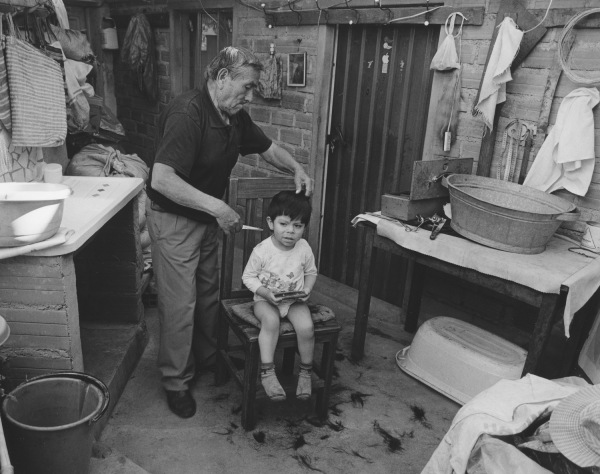 Grandfather cutting Grandson's hair