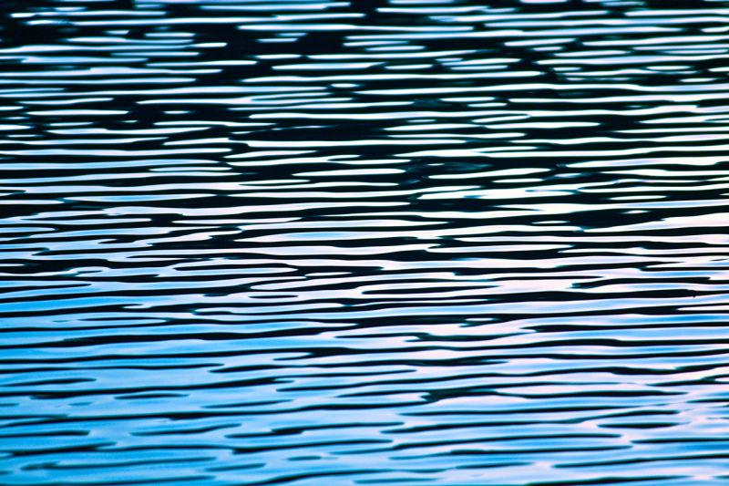 Reflective water at Bass Lake, California