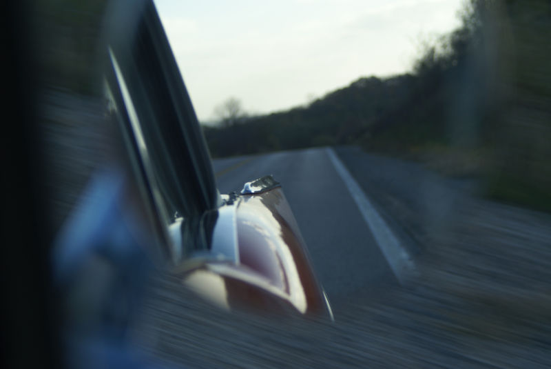 fin of Chevy Bel Air side mirror