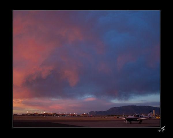 A Beechcraft Bonanza at sunset