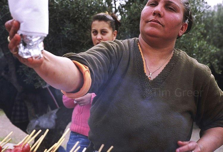 A street vendor handing over a gyro