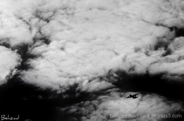 Iron Flyer Between  Clouds .