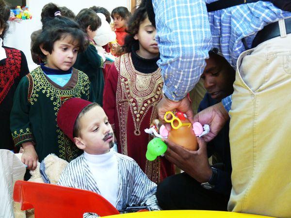 Peter and Kysaka initiate the kids into the Potato